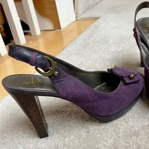 Purple leather heels with brass details